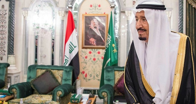 A photo made available by Saudi Press Agency shows Saudi King Salman bin Abdulaziz Al Saud standing in front of Iraqi and Saudi flags before meeting with Iraqi PM Haider Al-Abbadi not pictured in Riyadh, Saudi Arabia, June 19, 2017. EPA Photo