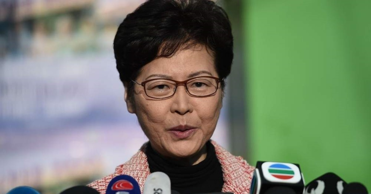 Hong Kong Chief Executive Carrie Lam speaks to the press after casting her vote during the district council elections, Hong Kong, Nov. 24, 2019. (AFP Photo)