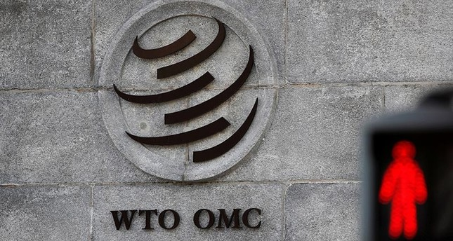 A logo is pictured outside the World Trade Organization (WTO) headquarters next to a red traffic light in Geneva, Switzerland, Oct. 2, 2018. (Reuters Photo)