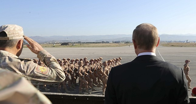 In this file photo taken on Tuesday, Dec. 12, 2017, Russian President Vladimir Putin, right, watches the troops marching as he and Syrian President Bashar Assad visit the Hemeimeem air base in Syria. AFP Photo