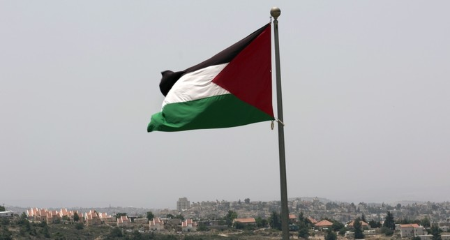 The Palestinian national flag flying from the highest point of the new West Bank Palestinian city of Rawabi, north of Ramallah, June 4, 2016.