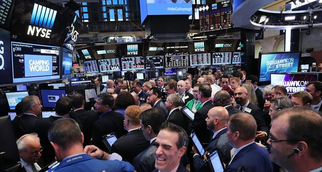 Traders work on the floor of the New York Stock Exchange. The recent soft numbers on the economy may have weakened the case for an increase in the benchmark lending rate by the Federal Reserve.