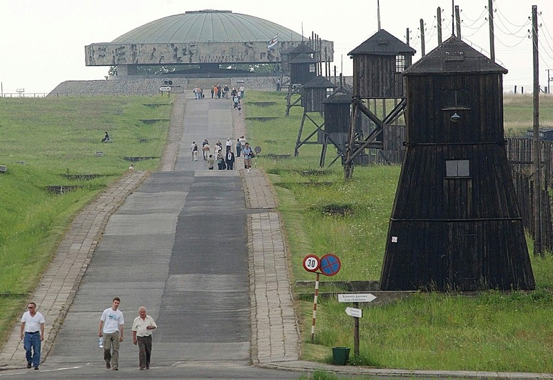 In this July 23, 2004 file photo, people are seen visiting the camp in front of the Majdanek memorial, in Majdanek, southeastern Poland. (AP Photo)