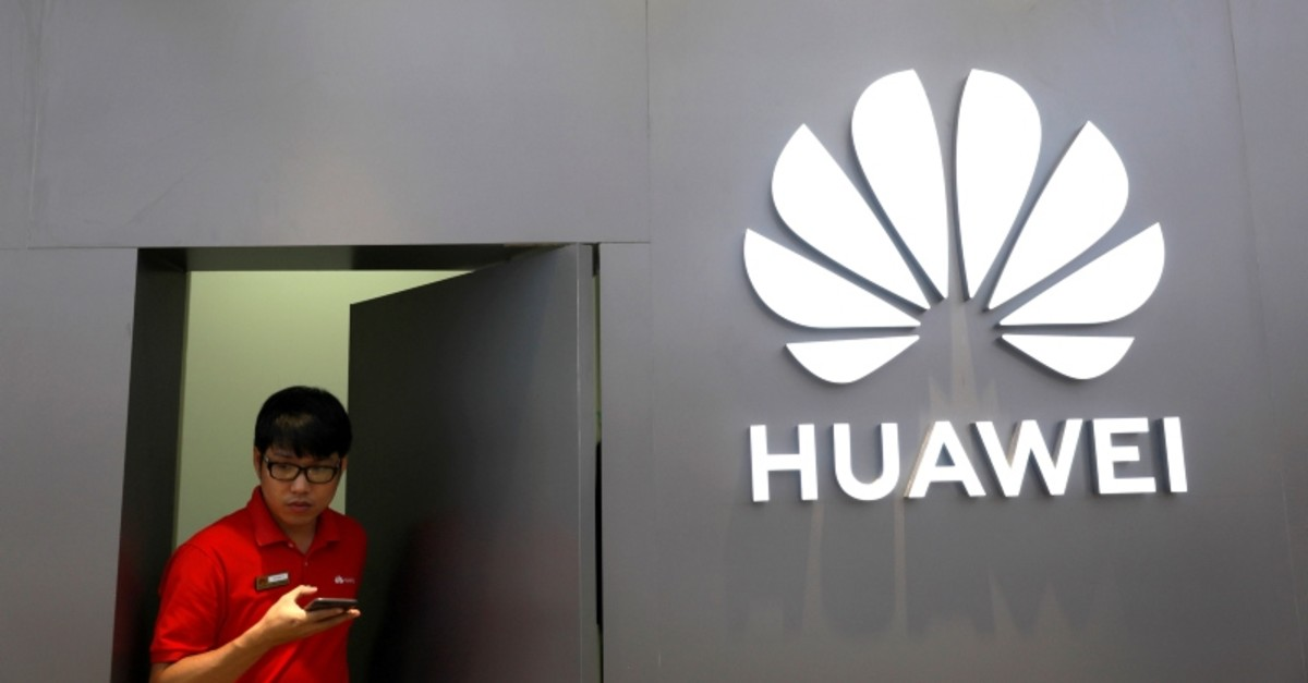 A staff uses a phone as he works at Huawei Flagship Store in Bangkok, Thailand May 23, 2019. (AFP Photo)