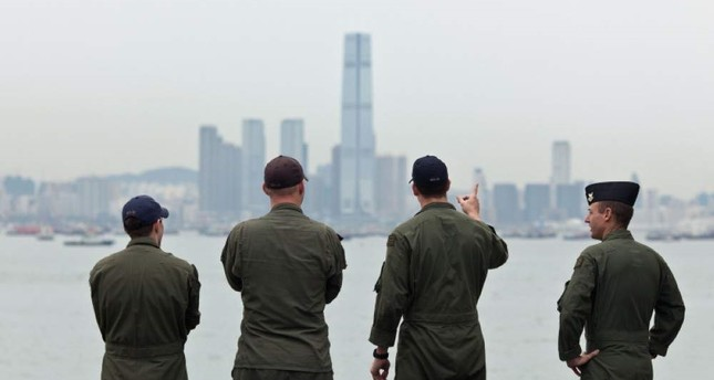 This file photo taken on August 20, 2014 shows U.S. Navy personnel on board the USS Makin Island looking towards the ICC building (C) during a port-of-call visit to Hong Kong. (AFP Photo)