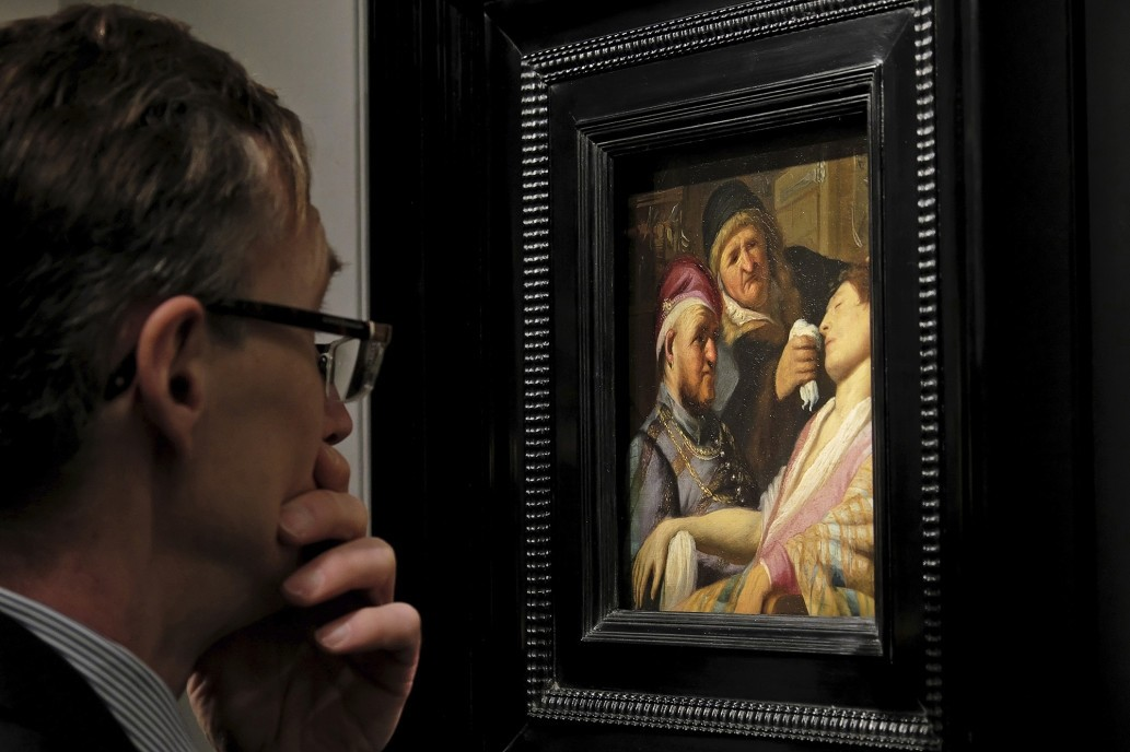 A man looks at Rembrandt's ,The Unconscious Patient (An Allegory of the Sense of Smell) (AP Photo)
