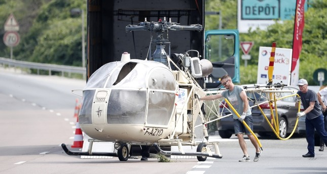 Investigators trasnport an Alouette II helicopter allegedly abandoned by French prisoner Redoine Faid and suspected accomplices after his escape from the prison of Reau, in Gonesse, north of Paris, France, 01 July 2018. (EPA Photo)