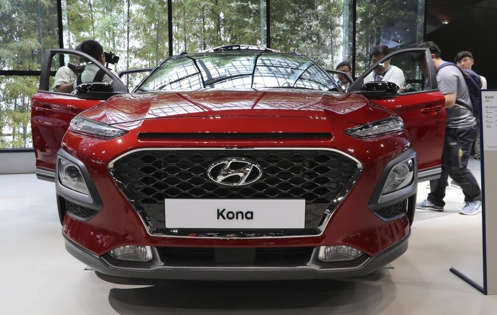 Media members and visitors surround Hyundai Motoru2019s new Kona SUV in Goyang, South Korea.