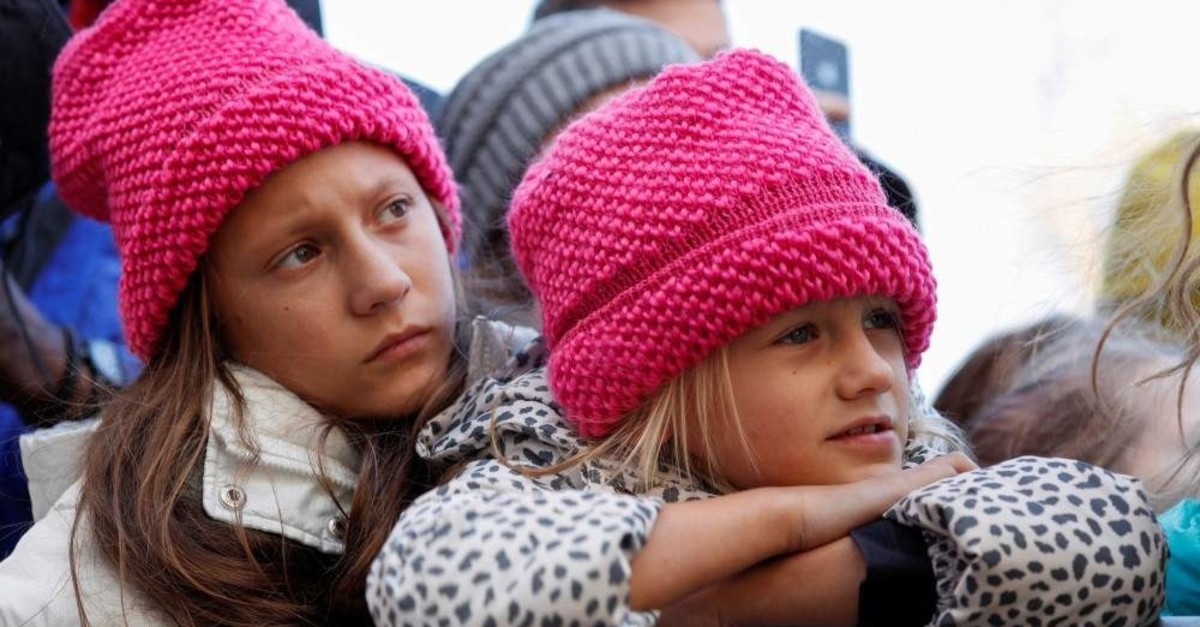 Two young girls listen as Swedish teen environmental activist Greta Thunberg leads a climate change rally in North Carolina, Nov. 8, 2019. (REUTERS)
