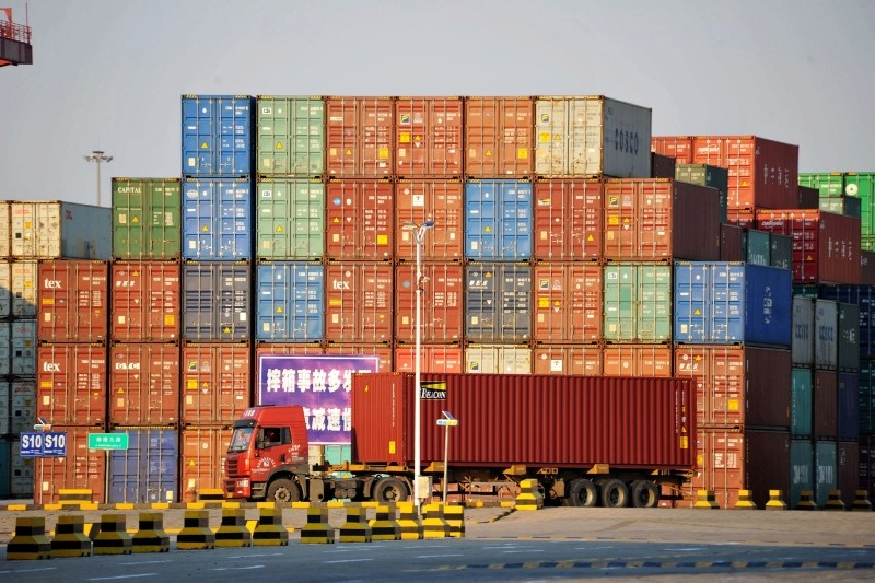 A truck transports a shipping container at Qingdao port in Shandong province, China October 12, 2018. (China Daily/via REUTERS)