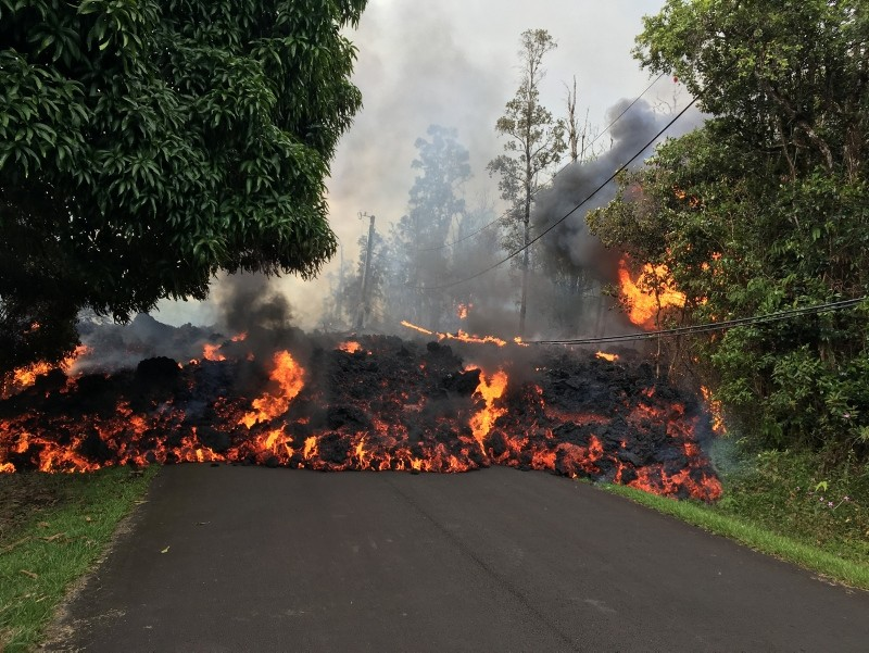 A lava flow from the Kilauea volcano, moves on a street in Leilani Estates in Hawaii, U.S. May 6, 2018 (Reuters Photo)