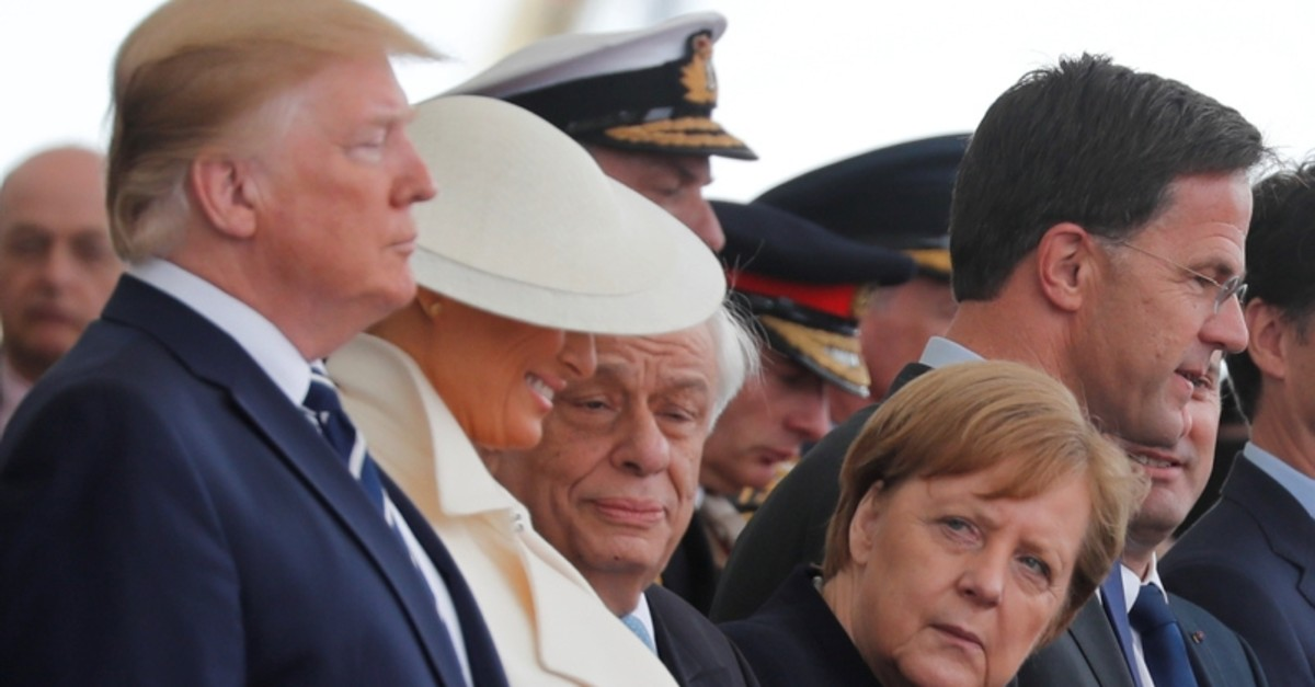 U.S. President Donald Trump, First Lady Melania, German Chancellor Angela Merkel and Dutch Prime Minister Mark Rutte participate in an event to commemorate the 75th anniversary of D-Day, in Portsmouth, Britain, June 5, 2019. (Reuters Photo)