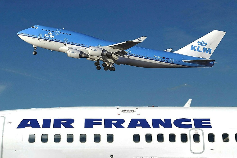 This Jan.1, 2003 file photo shows a KLM Boeing 747-400 flying over an Air-France plane at the Amsterdam Airport Schiphol in Amsterdam, Netherlands. (AFP Photo)