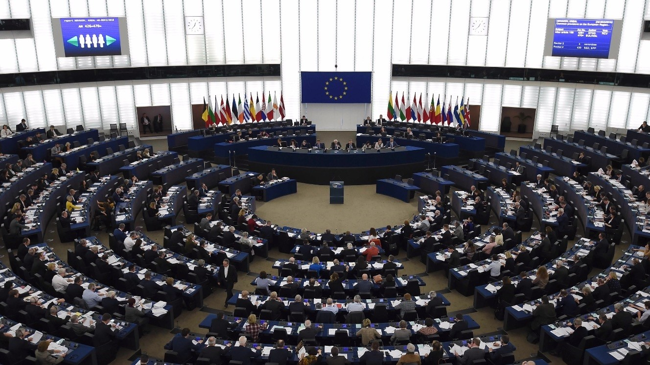 Members of the European Parliament take part in voting during a plenary session at the European Parliament, Strasbourg, eastern France, Feb. 13, 2019.