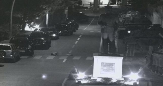 A surveillance camera image shows a victim's body lying on the ground after the soldiers dumped it from a military vehicle.
