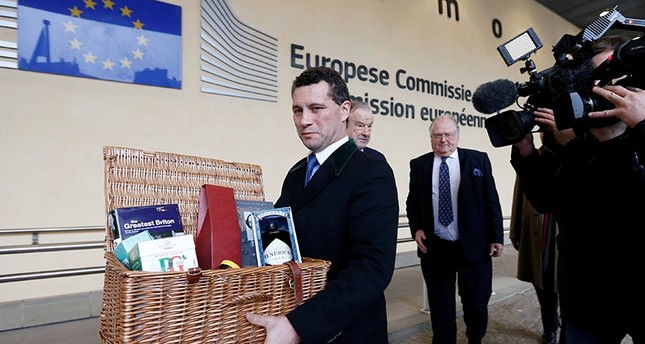 Member of the European Parliament (MEP) Steven Woolfe holds an hamper with British products as he arrives for a meeting with European Union's chief Brexit negotiator Michel Barnier (unseen) at the EU Commission headquarters (Reuters File Photo)