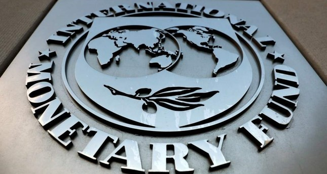 The International Monetary Fund logo seen outside its headquarters building, Washington. Sept. 4, 2018. (Reuters Photo)