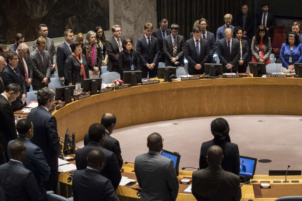 Members of the United Nations Security Council observe a moment of silence, New York City, May 15.
