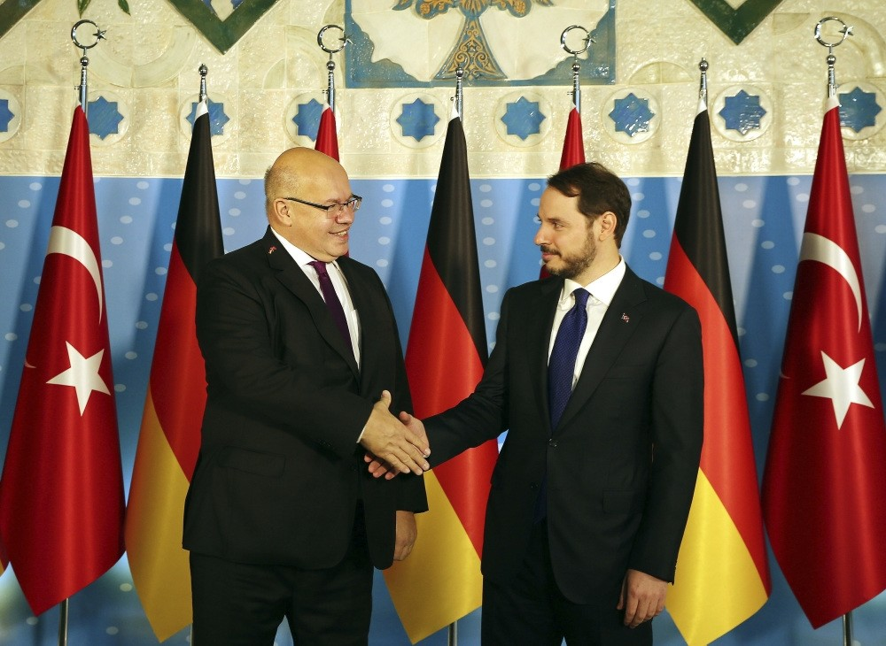 Treasury and Finance Minister Berat Albayrak (R) shakes hands with German Economy Minister Peter Altmaier (L) prior to their meeting in Ankara, Oct. 25.