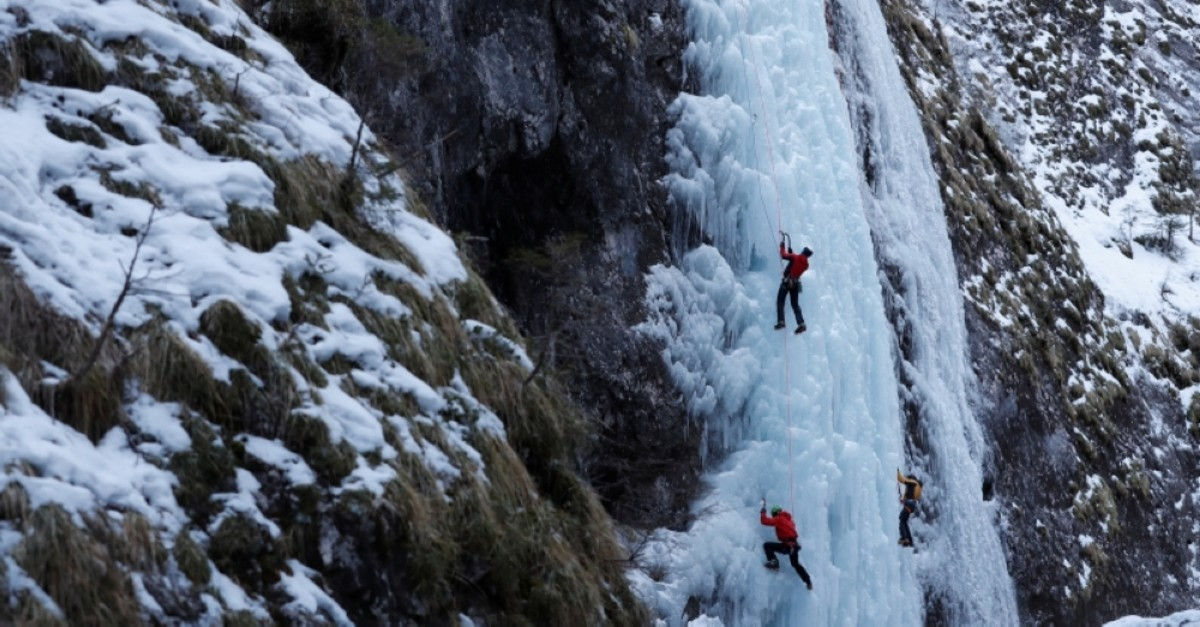 Italian alpine rescuers climb a frozen waterfall in Malga Ciapela, Italy, Feb. 11, 2020. (Reuters Photo)