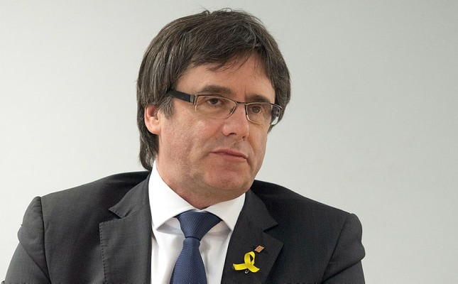 Former Catalan leader, Carles Puigdemont, attends a a meeting with members of the Junts per Catalunya party,  in a hotel in Berlin, Saturday, April 5, 2018. (dpa via AP)