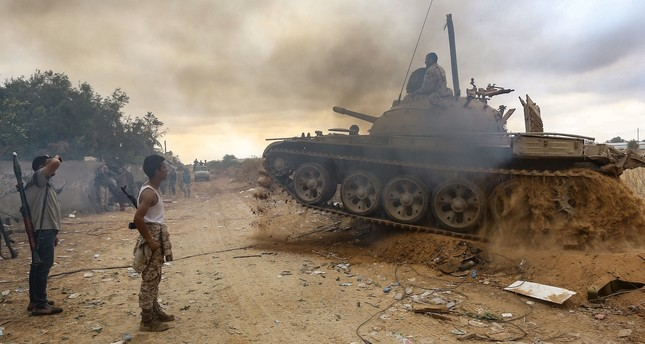 Fighters loyal to the internationally-recognized Government of National Accord (GNA) near the frontline during clashes, Tripoli, June 1, 2019.