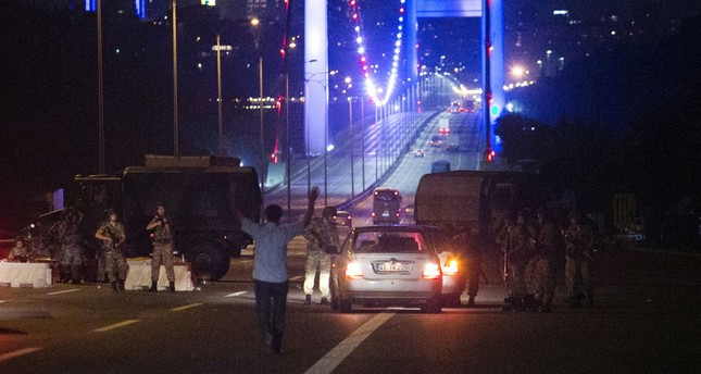 A man approaches putschist soldiers who closed down the Bosporus bridge with his hands, July 16, 2016. Putschists killed 251 people during the coup attempt.