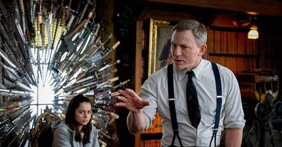 Ana de Armas as Marta Cabrera and Daniel Craig as Benoit Blanc in ,Knives Out.,