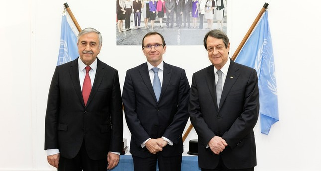 Mustafa Akinci (L), United Nations envoy Espen Barth Eide and Nicos Anastasiades. (AA Photo)