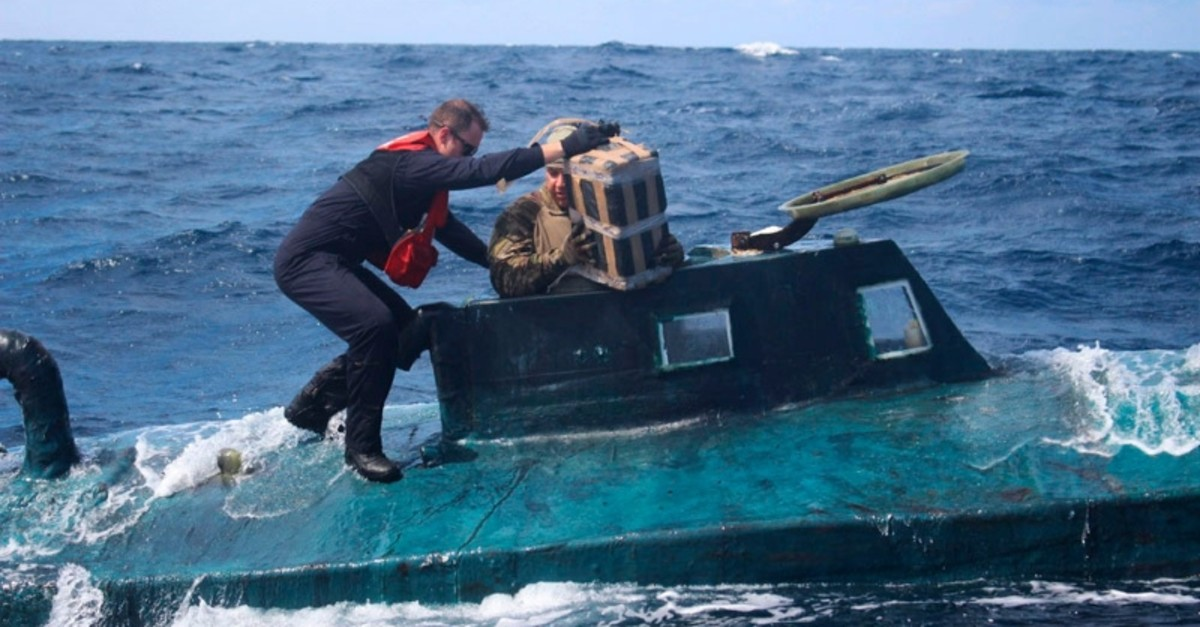 In this September 2019 photo made available by the U.S. Coast Guard, shows crew members of the cutter Valiant as they board a self-propelled semi-submersible in international waters. (AP Photo)