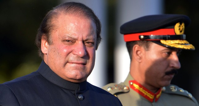 In this file photograph taken on June 5, 2013, Pakistani Prime Minister Nawaz Sharif arrives to inspect a guard of honour during a welcoming ceremony at the Prime Minister's House in Islamabad. (AFP Photo)