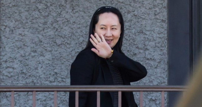 Huawei Chief Financial Officer Meng Wanzhou waves as she returns home after attending a court appearance in Vancouver, British Columbia, Wednesday May 8, 2019. AP Photo