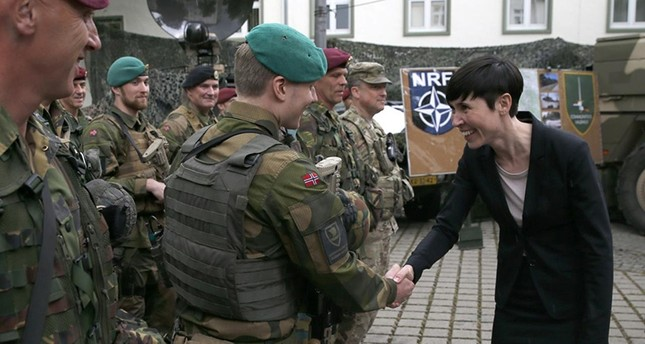 Norway's defense minister Ine Eriksen Soereide greets a Norwegian soldier during a visit to the Very High Readiness Joint Task Force (VJTF) unit in Muenster, Germany, June 22, 2015. (Reuters Photo)
