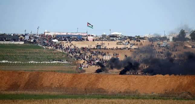 Smoke rises as Palestinians protest near the border fence on the Gaza side of the Israel-Gaza border, as seen from the Israeli side of the border, May 14, 2018 (Reuters Photo)