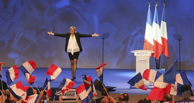 French far-right leader presidential candidate Marine Le Pen gestures at the start of a meeting in Nantes, western France. (AP Photo)