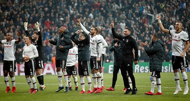 Beşiktaş's players celebrate after the Champions League Group G soccer match between Beşiktaş and FC Porto in Istanbul, Turkey, Nov. 21, 2017. (AP Photo)
