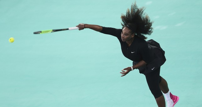 Serena Williams, of the U.S., serves the ball to Jelena Ostapenko, of Latvia, during the final day of the Mubadala World Tennis Championship in Abu Dhabi, Saturday, Dec. 30, 2017. (AP Photo)
