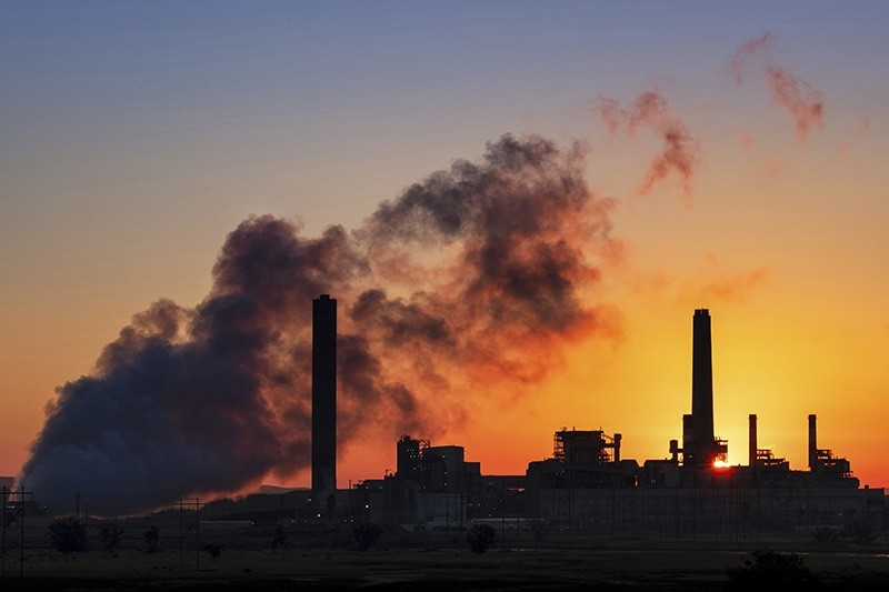 In this July 27, 2018 photo, the Dave Johnson coal-fired power plant is silhouetted against the morning sun in Glenrock, Wyo. (AP Photo)