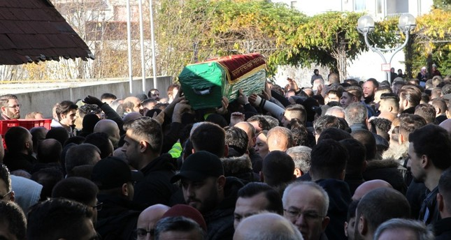 People carry the coffin of Mustafa Alptuğ Sözen during a funeral in Hanau, Germany.