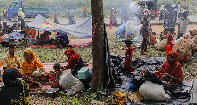 Newly arrived Rohingya refugees rest on the roadside after fleeing to Bangladesh from Myanmar in Ukhiya on Sept. 6, 2017. (AFP Photo)