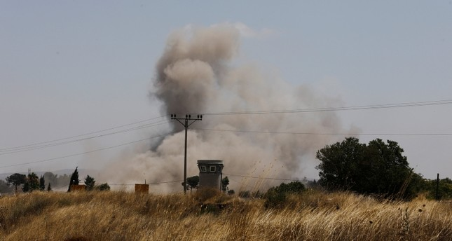 Smoke can be seen following an explosion near the Quneitra border crossing between Israel and Syria, as seen from the Israeli-occupied Golan Heights July 21, 2018. (Reuters Photo)