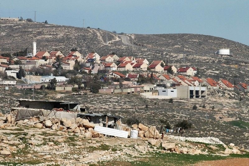 A general view of the illegal Israeli settlement of Bani Hever, southwest of the Israeli-occupied West Bank town of Hebron, surrounded by the Palestinian lands of Bani Na'im village. (File Photo)