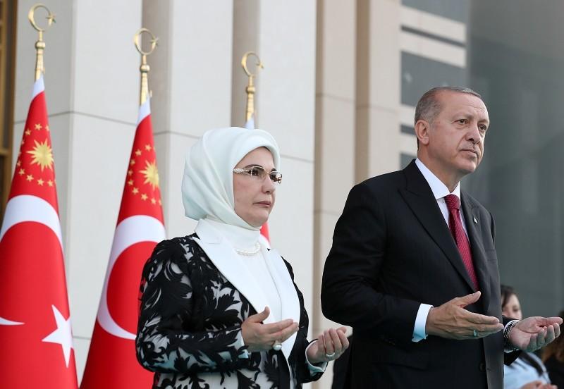 Erdoğan, next to his wife Emine ErdoĞan, prays during a ceremony at the Presidential Complex in Ankara, on July 9, 2018
