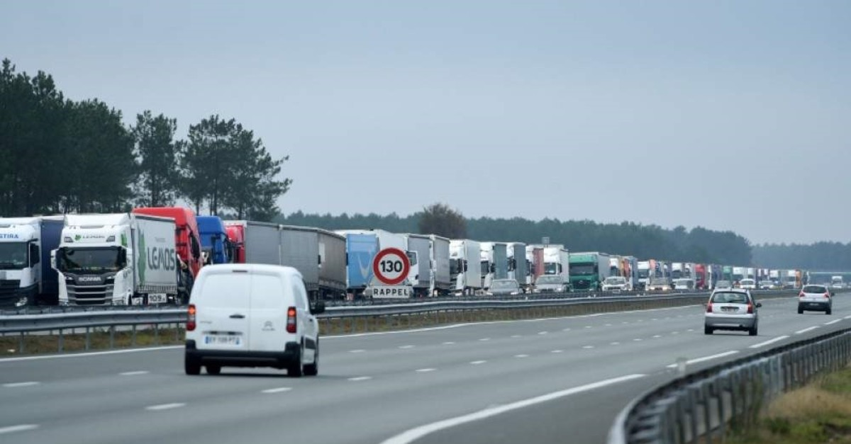 Trucks block the A63 highway during a national strike in France, Dec. 7, 2019. (AFP Photo)
