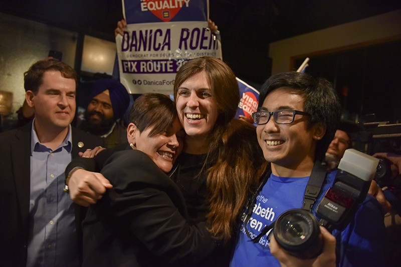 Danica Roem, center, who ran for house of delegates against GOP incumbent Robert Marshall, is greeted by supporters as she prepares to give her victory speech with Prince William County (AP Photo)