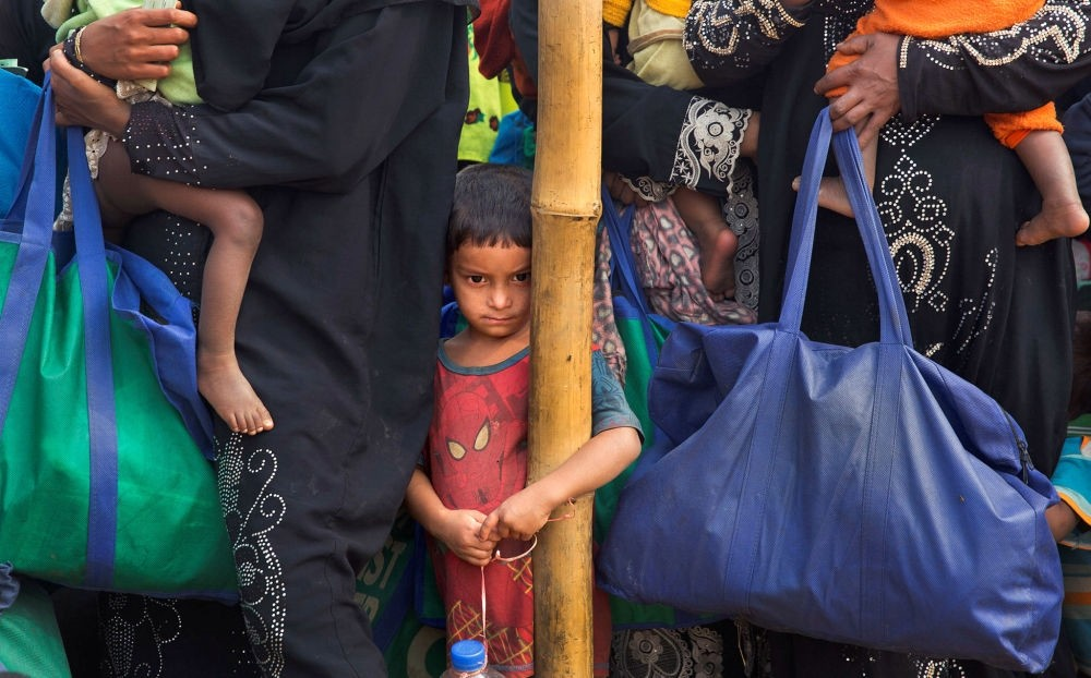 A Rohingya Muslim boy stands in a queue outside a food distribution center at Balukhali refugee camp, Bangladesh, Jan. 15.