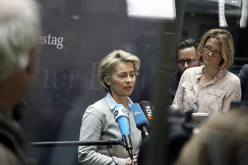 German Defense Minister Ursula von der Leyen, center, briefs the media as she arrives for a meeting of the German parliament's committee for defense in Berlin, Wednesday, May 10, 2017. (AP Photo)