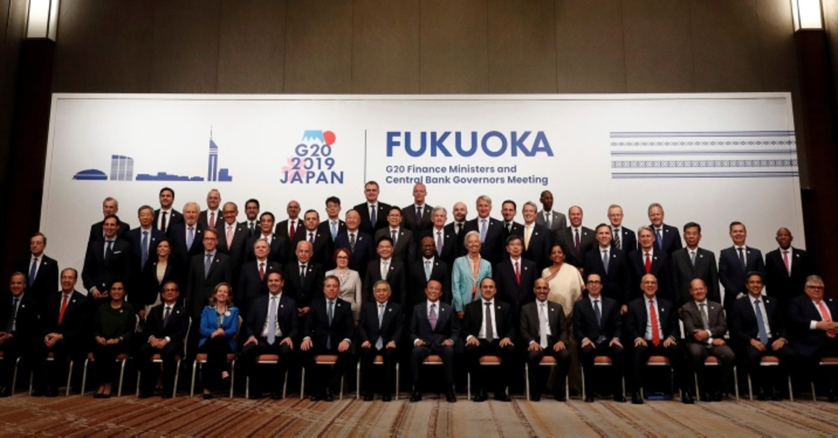 Japan's Finance Minister Taro Aso poses with delegations members for a family photo during the G20 Finance Ministers and Central Bank Governors Meeting in Fukuoka, Japan June 9, 2019. (Reuters Photo)