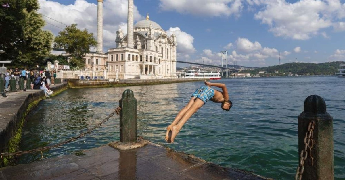 A young man jumps into the sea amid soaring temperatures, Istanbul, Aug. 3, 2019. (AA Photo)