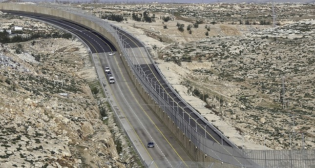 A newly opened segregated West Bank highway, right side of the wall, is seen near Jerusalem Thursday, Jan. 10, 2019. AP Photo